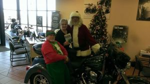 Santa and his helpers check out a new way to deliver copies of Ride Minnesota.