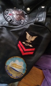 Adding Ralph's Navy crow to his motorcycle jacket.